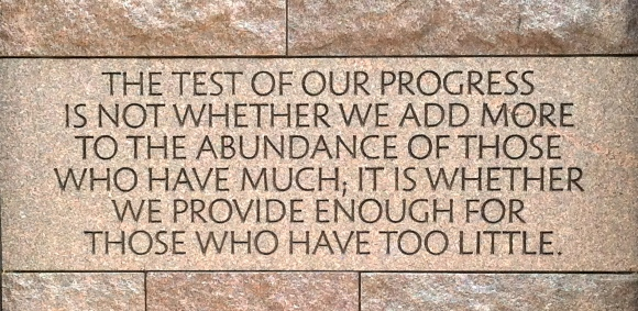 "The ""Test of our progress"" quote from FDR etched in stone."